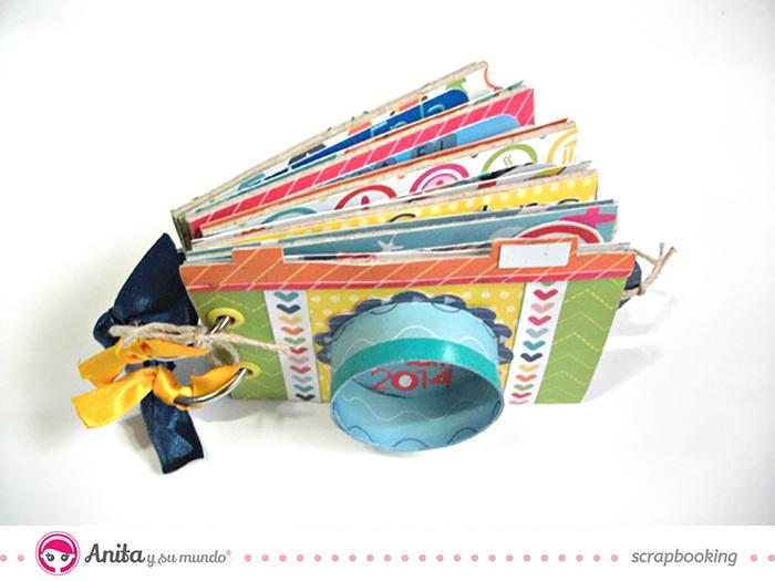 Mini álbum hecho con papel scrapbook y rollos de papel higiénico 1