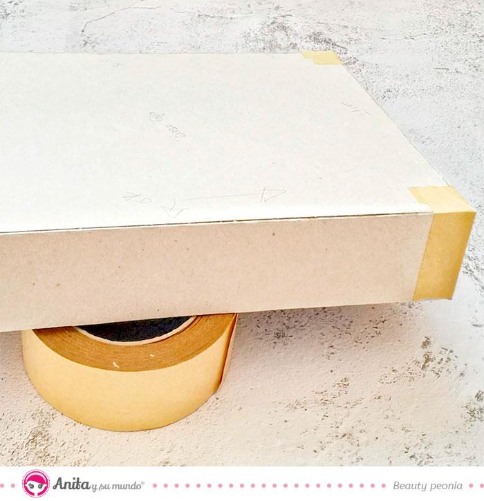 como reforzar cajas de cartón con cinta adhesiva